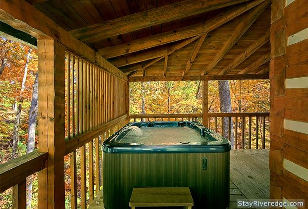 Deck view with hot tub at Woodland Wonder